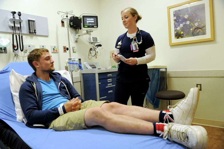 Christian Lankester, 25, receives treatment from nurse Kathryn Hicks at New Milford Hospital for poison ivy. New Milford Hospital's Arnhold Emergency Department opened this week. Photo: Carol Kaliff / Hearst Connecticut Media / The News-Times