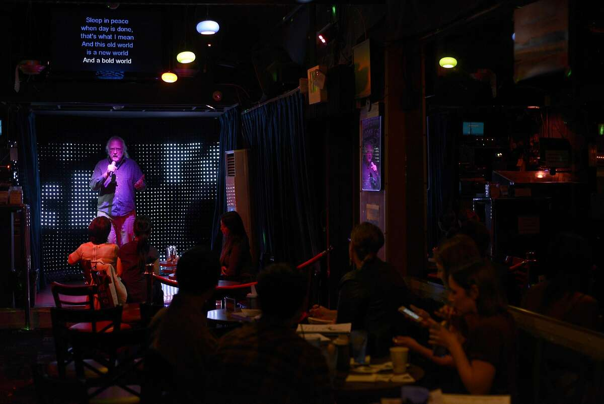 David Richey, 63, performs karaoke for an audience at The Mint on Market Street in San Francisco, California, on Wednesday, June 10, 2015.
