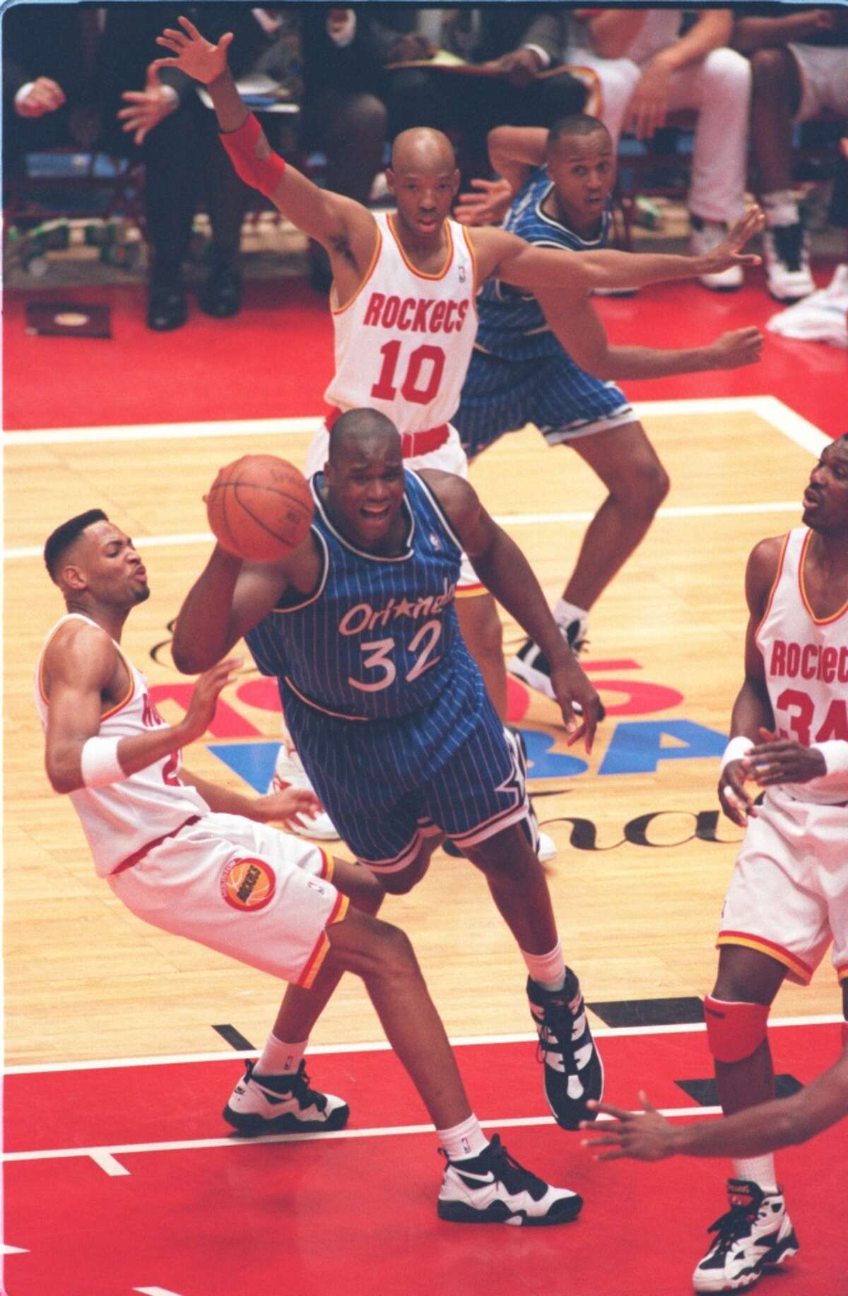 06/14/1995 - Houston Rockets vs. Orlando Magic: game 4 of the 1995 NBA Finals. Rockets' Robert Horry, Magic's Shaquille O'Neal (32), Rockets' Hakeem Olajuwon (34), and Rockets' Sam Cassell (10).