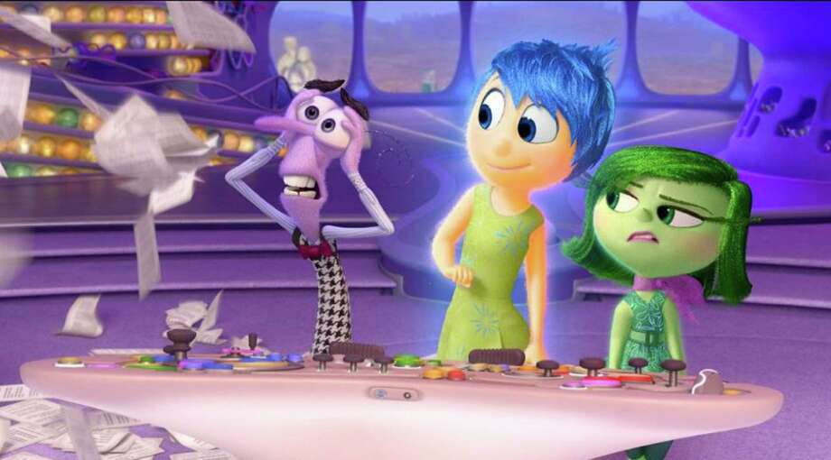 "A scene from ""Inside Out"" showing Anger, from left, (voiced by Lewis Black) Joy (Amy Poehler) and Disgust (Mindy Kaling). (Pixar) Photo: Handout, HO / Pixar"