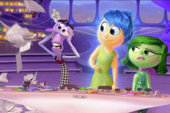 """A scene from """"Inside Out"""" showing Anger, from left, (voiced by Lewis Black) Joy (Amy Poehler) and Disgust (Mindy Kaling). (Pixar)"""