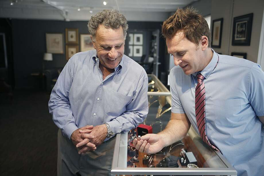 Father-son Joseph Chait (father,left) and Marcus Chait (son, right), look at a Cartier diamond ring just sold this morning at  66Mint in San Francisco, California, on Thursday, June 11, 2015.  During the 1950's the asset based lender has evolved into being recognized as one of the premier estate jewelry dealers in the country and has opened a sell center in Silicon Valley this month. Photo: Liz Hafalia, The Chronicle