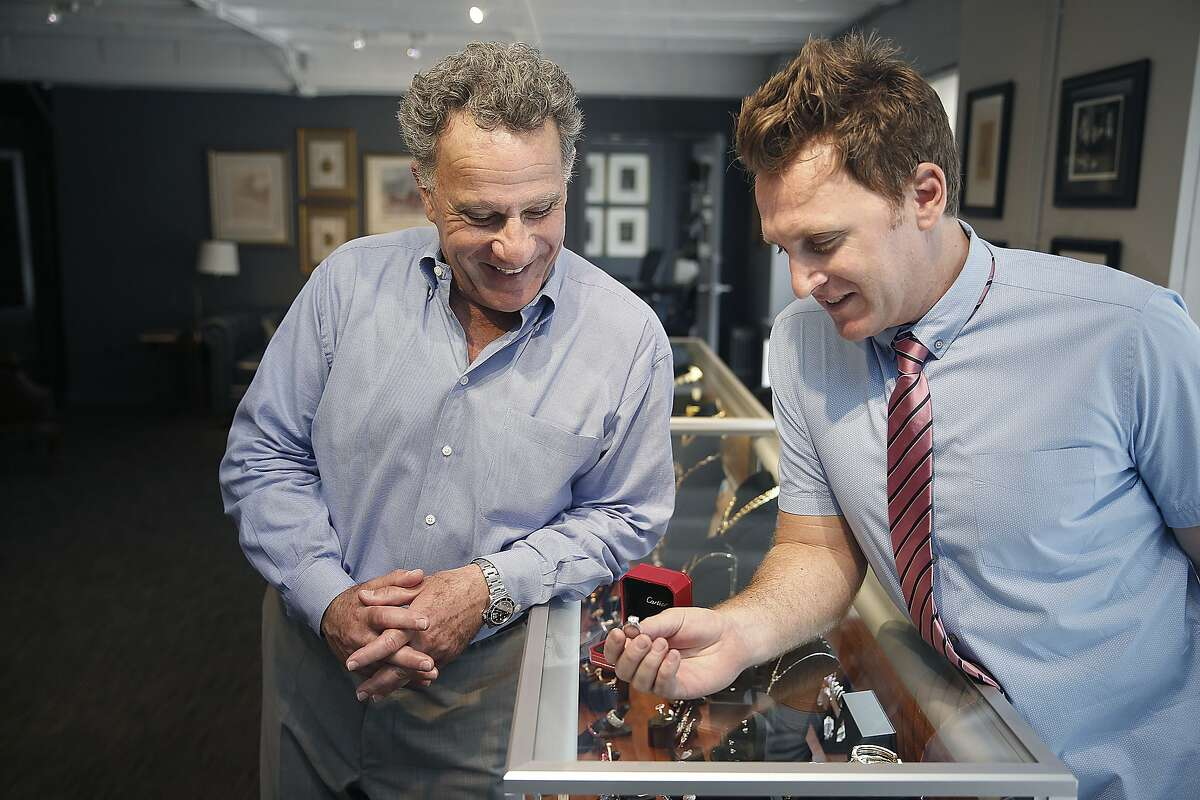 Father-son Joseph Chait (father,left) and Marcus Chait (son, right), look at a Cartier diamond ring just sold this morning at 66Mint in San Francisco, California, on Thursday, June 11, 2015. During the 1950's the asset based lender has evolved into being recognized as one of the premier estate jewelry dealers in the country and has opened a sell center in Silicon Valley this month.