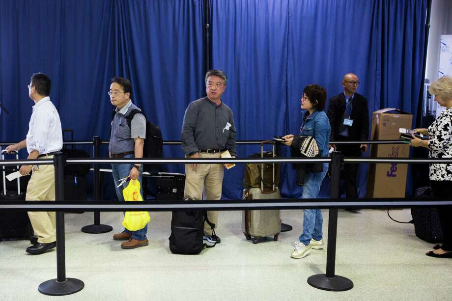 Passengers wait for their turn to board the ANA flight 173 to Tokyo from Houston Bush International Airport at the Terminal D Gate five, Friday, June 12, 2015, in Houston. ( Marie D. De Jesus / Houston Chronicle ) Photo: Marie D. De Jesus, Staff / © 2015 Houston Chronicle
