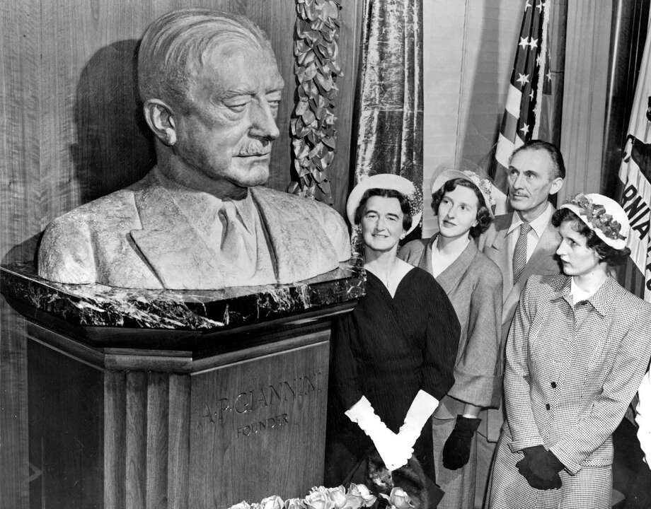 A bust of A.P. Giannini is admired by Mrs. Clifford P. Hoffman (left), Ann Giannini, artist Holger Jensen and Virginia Giannini, in a picture taken the year after his death. Photo: Barney Peterson / Barney Peterson / The Chronicle 1950 / ONLINE_YES