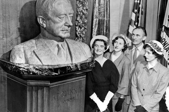 A bust of A.P. Giannini is admired by Mrs. Clifford P. Hoffman (left), Ann Giannini, artist Holger Jensen and Virginia Giannini, in a picture taken the year after his death.