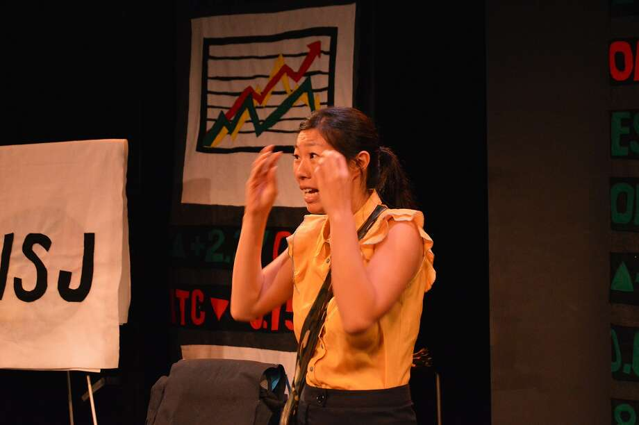 "Comic Kristina Wong of San Francisco examines the economy and her trip to Uganda in ""The Wong Street Journal."" Photo: Diana Wyenn"
