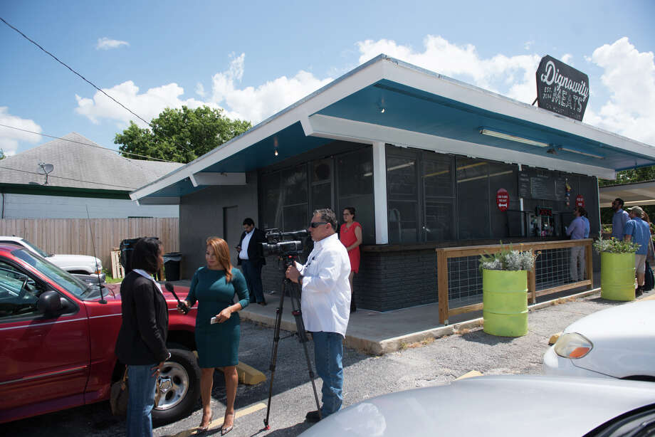 Mayor Ivy Taylor does and interview during a lunch-time campaign stop at Dignowity Meats on east Houston St. Friday. Photo: Robin Jerstad / San Antonio Express-News