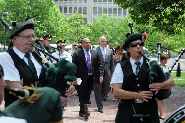 Local law enforcement official walk in a procession to begin a ceremony at the Crime Victims' Memorial and Walkway at the Empire State Plaza on Friday June 12, 2015 in Albany , N.Y.  (Michael P. Farrell/Times Union) Photo: Michael P. Farrell, Albany Times Union / 00032272A