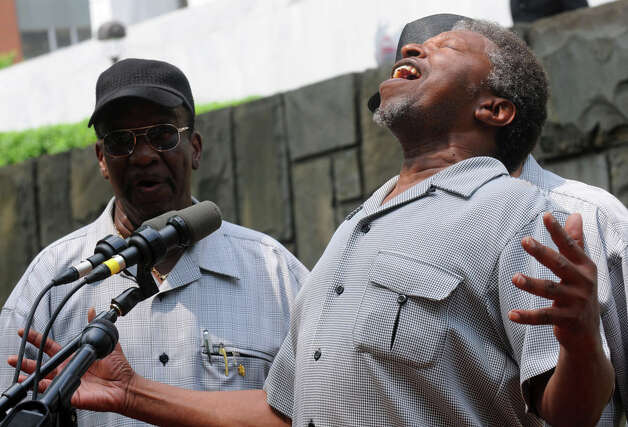Members of the Mount Olive Missionary Baptist Church Men's Choir perform during a ceremony at the Crime Victims' Memorial and Walkway at the Empire State Plaza on Friday June 12, 2015 in Albany , N.Y.  (Michael P. Farrell/Times Union) Photo: Michael P. Farrell, Albany Times Union / 00032272A