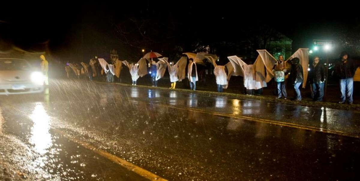"""70 or so demonstrators wearing wings made of sheets lined up in front of the Brookfield Theater despite heavy rain and high winds to block the public view of protestering Members of the Westboro Baptist Church of Topeka, Kan., which planned to picket outside the theater during its last performance of """"The Laramie Project"""". The play is based on the murder of Matthew Shepard, a 21-year-old gay college student who was kidnapped, beaten and left to die in Laramie, Wyo., in 1998. Saturday, Mar. 13, 2010"""