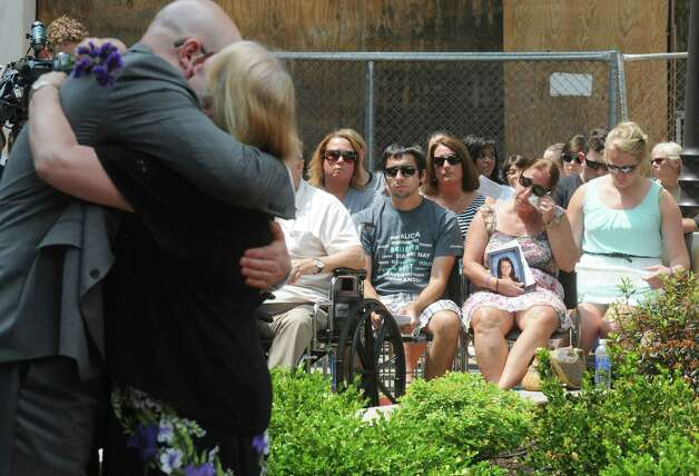 Lori Caponigo Tamboia, right, of Dover holds a photo of her daughter  Alicia Tamboia who was killed in a 2014 auto accident during a ceremony at the Crime Victims' Memorial and Walkway at the Empire State Plaza on Friday June 12, 2015 in Albany , N.Y.  (Michael P. Farrell/Times Union) Photo: Michael P. Farrell / 00032272A