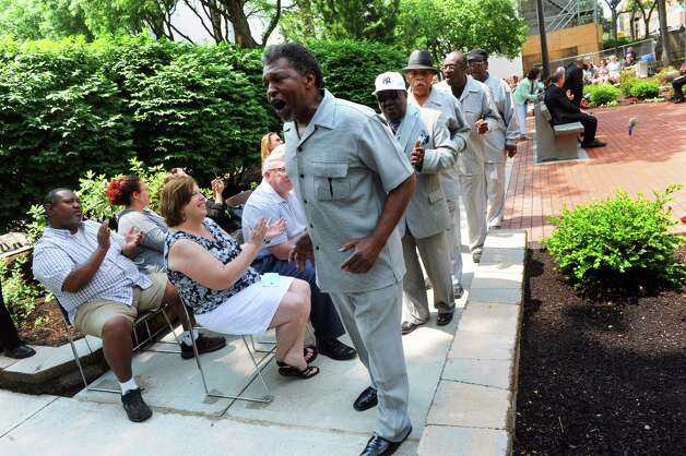 Members of the Mount Olive Missionary Baptist Church Men's Choir perform during a ceremony at the Crime Victims' Memorial and Walkway at the Empire State Plaza on Friday June 12, 2015 in Albany , N.Y.  (Michael P. Farrell/Times Union) Photo: Michael P. Farrell / 00032272A