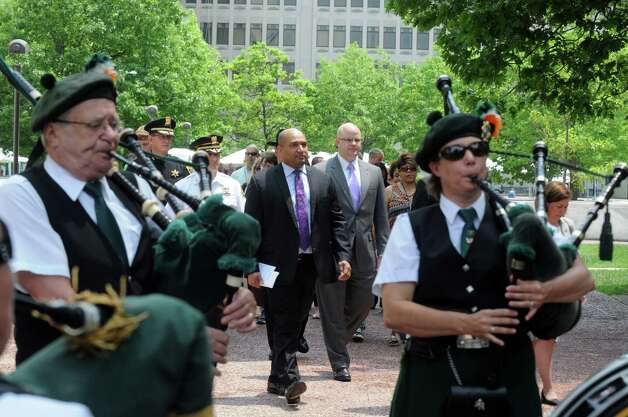 Local law enforcement official walk in a procession to begin a ceremony at the Crime Victims' Memorial and Walkway at the Empire State Plaza on Friday June 12, 2015 in Albany , N.Y.  (Michael P. Farrell/Times Union) Photo: Michael P. Farrell / 00032272A