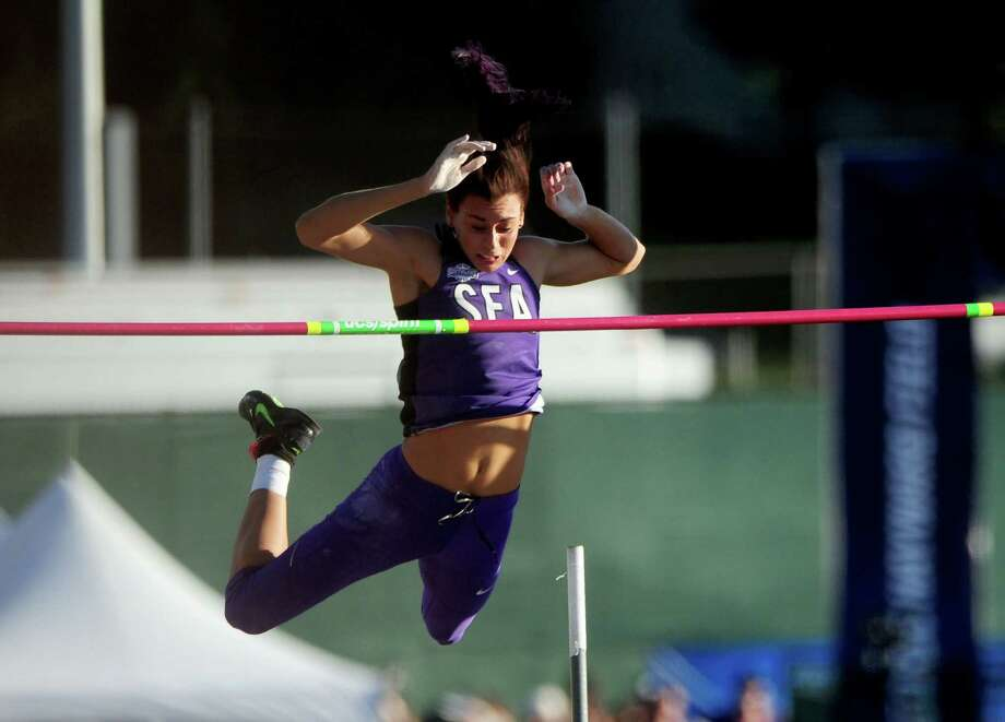 Stephen F. Austin's Demi Payne clears the bar en route to winning the women's pole vault during the NCAA track and field championships at Hayward Field, on June 11, 2015, in Eugne, Ore. Photo: Brent Drinkut /Associated Press / Statesman Journal