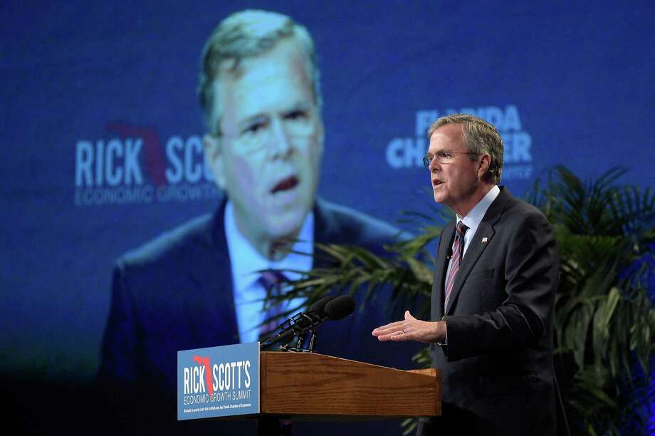 Former Florida Gov. Jeb Bush speaks during a summit on economic growth earlier this month in Lake Buena Vista, Fla. A reader criticizes Bush for recent comments he made on climate change. Photo: Phelan M. Ebenhack /Associated Press / FR121174 AP