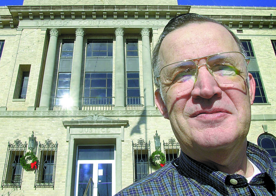 Charles Sebasta was County District Attorney Charles Sebesta stands outside the county courthouse where he has worked for 25 years. Friday was his last day of work. butch foto / The Bryan-College Station Eagle