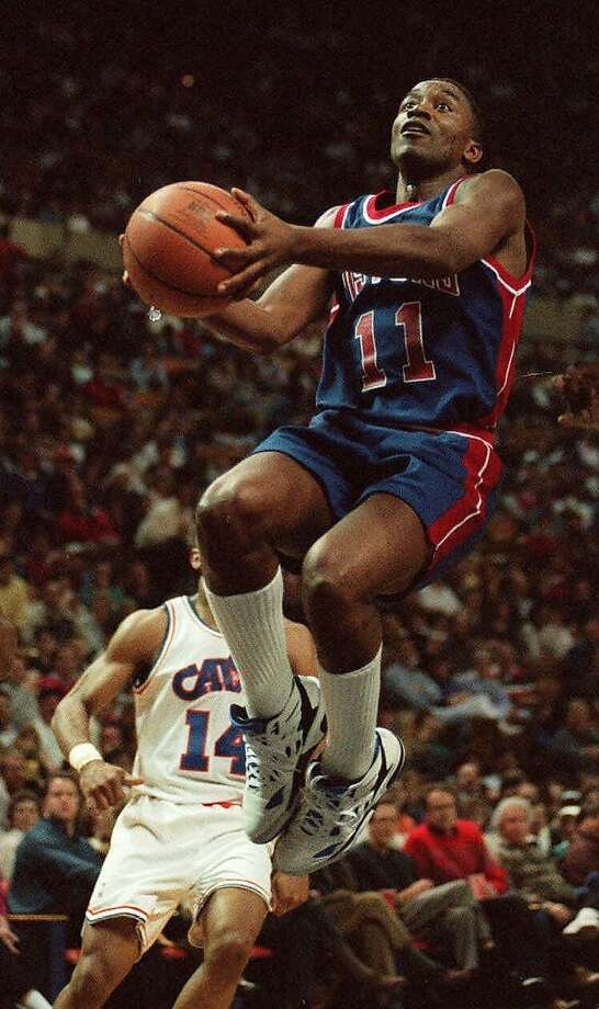 FILE--Detroit Pistons' Isiah Thomas, (11) goes to the basket against the Cleveland Cavalieers in this March, 27, 1994 file photo. Thomas will take his place in the Basketball Hall of Fame on Friday,  Oct. 13, 2000. (AP Photo/Mark Duncan) Photo: Mark Duncan, Associated Press
