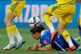 WINNIPEG, MB - JUNE 12:  Carli Lloyd #10 of the United States reacts as the ball hits her head after a corner in the second half against Sweden in the FIFA Women's World Cup Canada 2015 match at Winnipeg Stadium on June 12, 2015 in Winnipeg, Canada.  (Photo by Kevin C. Cox/Getty Images)