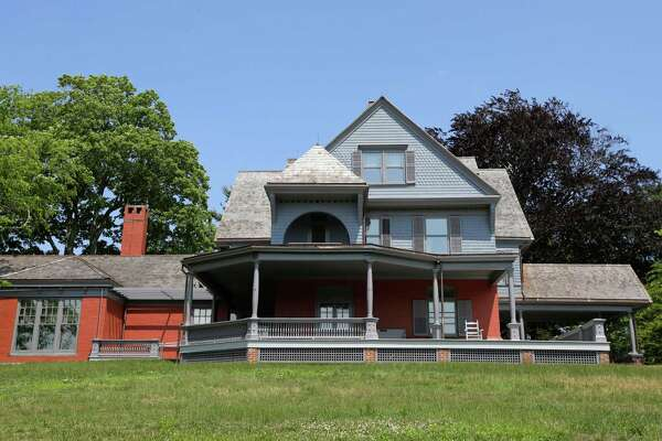 """In this June 9, 2015, photo, Sagamore Hill, Theodore Roosevelt's  """"Summer White House,""""  is shown at Sagamore Hill National Historic Site in Oyster Bay, N.Y. The three-story, 28-room mansion, named by Roosevelt after the Indian chief Sagamore Mohannis, will reopen July 12, 2015,  after a four-year, $10 million renovation by the National Park Service."""