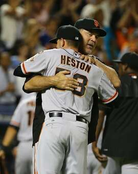 NEW YORK, NY - JUNE 09:  Chris Heston #53 of the San Francisco Giants celebrates his no hitter with manager Bruce Bochy #15  against the New York Mets  after their game at Citi Field on June 9, 2015 in New York City.  (Photo by Al Bello/Getty Images)