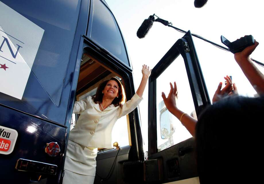 FILE - Rep. Michele Bachmann (R-Minn.) greets the crowd after winning the Iowa Straw Poll, in Ames, Iowa, Aug. 13, 2011. The poll, a longstanding Republican tradition whose significance was diminished after Bachmann finished at the back of the pack in the Iowa caucuses, will not be held in the 2016 presidential cycle, party officials said on June 12, 2015. (Eric Thayer/The New York Times) Photo: ERIC THAYER, STR / New York Times / NYTNS