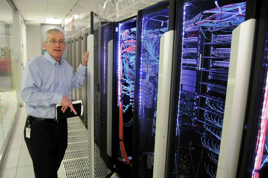 BP's Keith Gray, director of technical computing and the Center for High Performance Computing, talks about the company's computing power during a tour of the facilities recently. Photo: Dave Rossman /For The Chronicle / Freelalnce