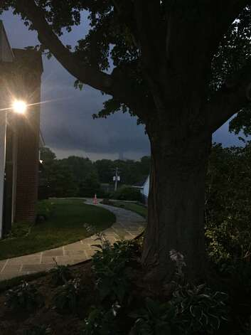 Darkening skies can be seen near Loudonville Friday night as part of a storm that caused outages and downed trees. (Courtesy Jack Hayes)