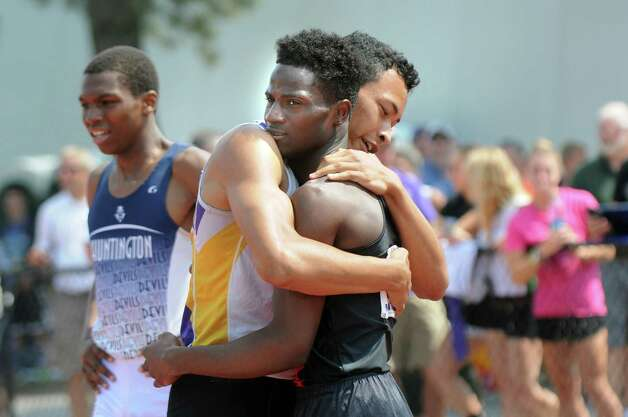 Amsterdam's Izaiah Brown, right, embraces Richard Rose of the Boys and Girls High School after the 400-meter run during the state track meet on Friday, June 12, 2015, at UAlbany in Albany, N.Y. Brown, who took first, and Rose, who took second, have continued a friendly rivalry since they were both freshmen. (Cindy Schultz / Times Union) Photo: Cindy Schultz / 10032255A
