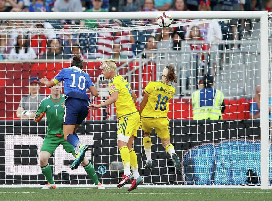 The U.S. just misses scoring in the second half when a header by Carli Lloyd (10) goes just over the crossbar after she got by Sweden's Caroline Seger, second from right, and Jessica Samuelsson (18). Photo: John Woods, SUB / The Canadian Press