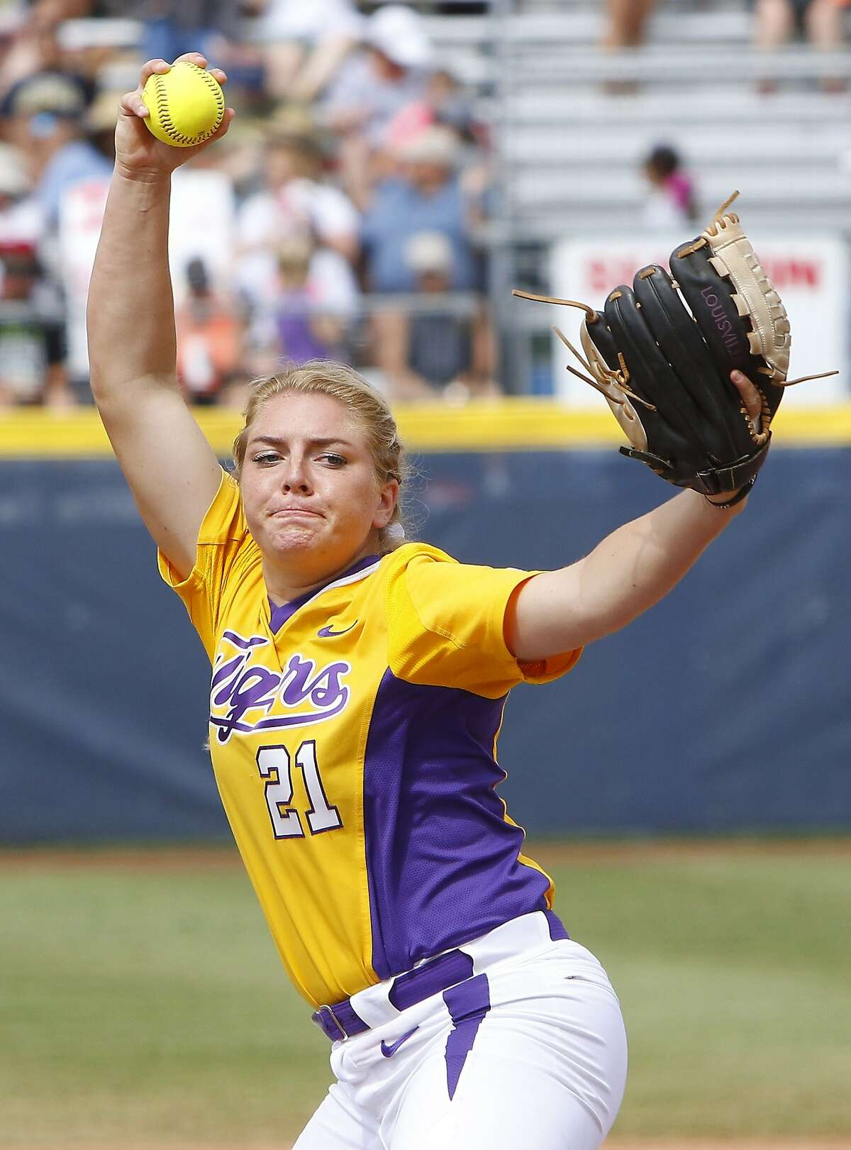 LSU's Carley Hoover pitches in the second inning during an NCAA Women's College World Series softball game against Michigan in Oklahoma City, Sunday, May 31, 2015. Michigan won 6-3 and moves onto the championship series. (AP Photo/Alonzo Adams)