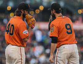 Giants pitcher Madison Bumgarner (40) meets with first baseman Brandon Belt (9) at the mound during a game between the San Francisco Giants and Arizona Diamondbacks at AT&T Park in San Francisco, California, on Friday, June 12, 2015.