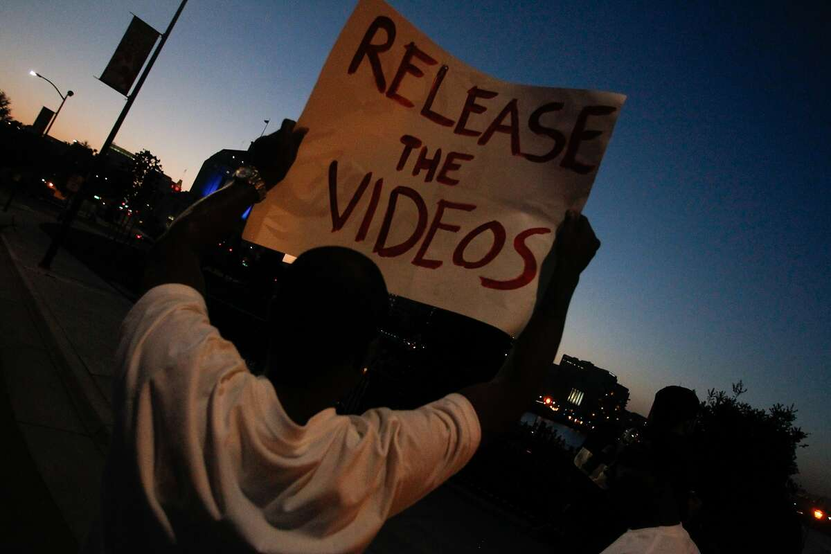 A protester holds up a sign demanding the release of video evidence of the shooting of Demouria Hogg, who was shot and killed by Oakland Police on Saturday, in Oakland, Calif., on Friday, June 12, 2015.