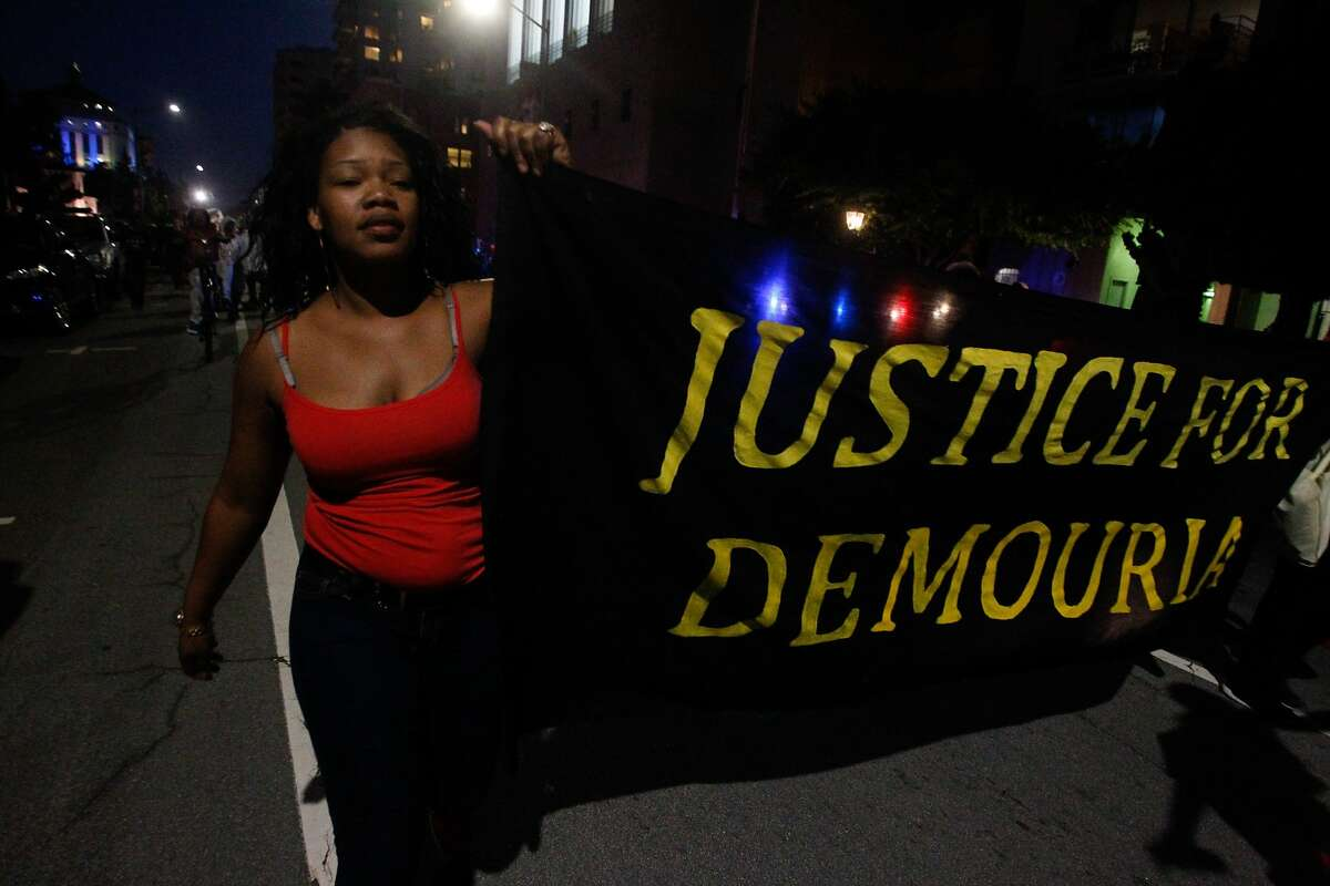 A protester marches with other to protest the shooting of Demouria Hogg by Oakland Police on Saturday, in Oakland, Calif., on Friday, June 12, 2015.