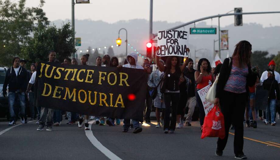 Protesters march along Lake Merritt to protest the shooting of Demouria Hogg by Oakland Police on Saturday, in Oakland,  Calif., on Friday, June 12, 2015. Photo: Mathew Sumner, Special To The Chronicle