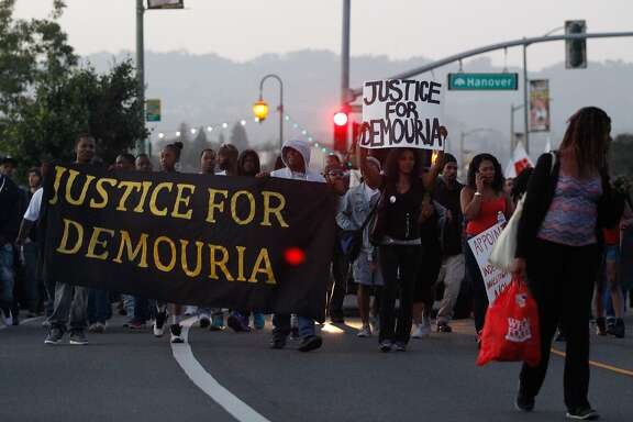 Protesters march along Lake Merritt to protest the shooting of Demouria Hogg by Oakland Police on Saturday, in Oakland,  Calif., on Friday, June 12, 2015.