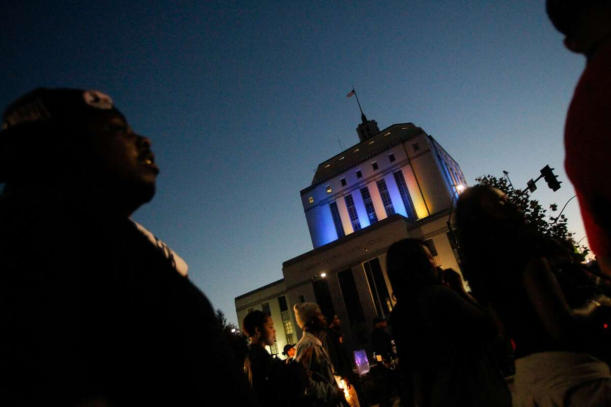 Protesters march in front of the Rene C. Davidson Courthouse to protest the shooting of Demouria Hogg by Oakland Police on Saturday, in Oakland, Calif., on Friday, June 12, 2015.