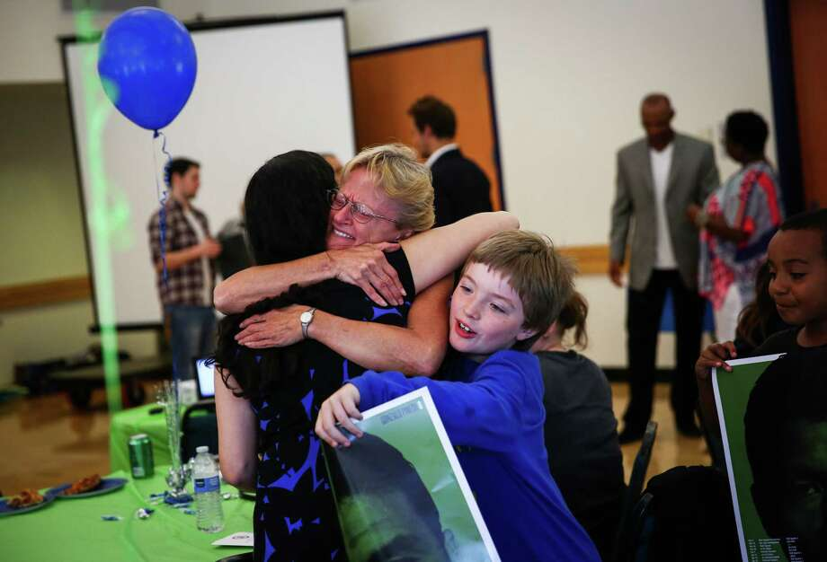 Sheryl Spencer and her grandson Lance Wegner, 9, hug a staff member from the King County Prosecutor's Office during an event honoring students who completed a truancy program. Wegner participated in the program. Students who completed the program were honored by Prosecutor Dan Satterberg, former Sounders player Roger Levesque and former Seahawks player Paul Johns at the Tukwila Community Center. Photo: JOSHUA TRUJILLO, SEATTLEPI.COM / SEATTLEPI.COM