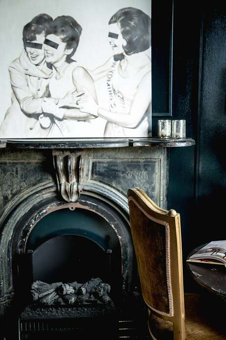 The fireplace in the den is from Berkeley's Ohmega Salvage. Photo: Aubrie Pick, Special To The Chronicle