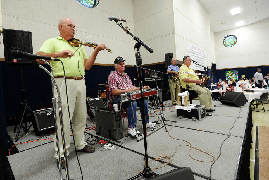 Jackie Caillier and the Cajun Cousins perform during Saturday's Breakfast with the Bishop. The 24th annual Breakfast with the Bishop was hosted by the Most Rev. Curtis J. Guillory at St. Jude Thaddeus Catholic Church on Saturday morning. The breakfast serves as a fundraiser for Catholic charities. Photo taken Saturday 6/13/15 Jake Daniels/The Enterprise Photo: Jake Daniels / ©2015 The Beaumont Enterprise/Jake Daniels