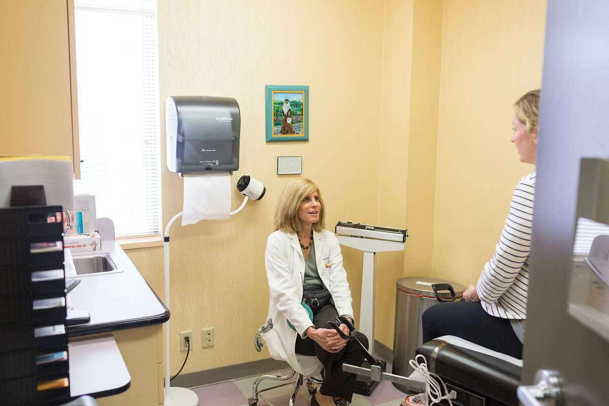 Dr. Laurie Green, SF OB-GYN, MAVEN founder and past president of the Harvard Medical School Alumni Association talks with a patient at her practice in San Francisco, Calif., Saturday June 13, 2015.