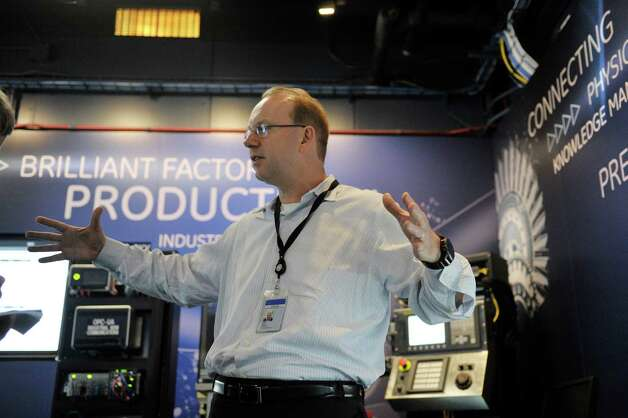 Stephan Biller, GE chief manufacturing scientist, talks about the work being done in the Brilliant Factory at the GE Global Research Center on Tuesday, June 9, 2015, in Niskayuna, N.Y.  The Brilliant Factory is a virtual lab where factory production floors can be created and modified and virtual equipment can be created.    (Paul Buckowski / Times Union) Photo: PAUL BUCKOWSKI / 00032209A