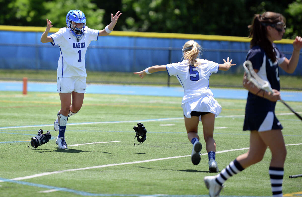 Darien goalie Samantha Nielsen and teammate Lillian Gregory celebrate after defeating Wilton in the Class L girls lacrosse championship Saturday, June, 13, 2015, at Bunnell High School in Stratford, Conn.