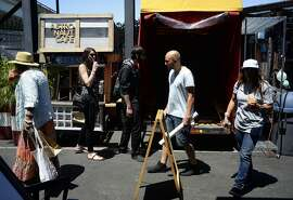 """Attendees walk around at the """"Get Baked Sale"""" located at SoMa StrEat Food Park in San Francisco, California, on Saturday, June 13, 2015."""