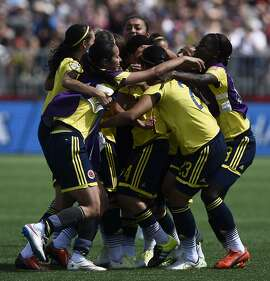 Colombia's players celebrates their victory against France  during a Group F match at the 2015 FIFA Women's World Cup between France and Colombia at Moncton Stadium, New Brunwick on June 13, 2015. Colombia won 0-2. AFP PHOTO / FRANCK FIFEFRANCK FIFE/AFP/Getty Images