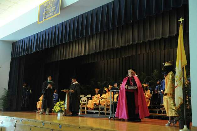 Bishop Maginn High School held its 35th Commencement Exercise on Saturday June 13, 2015 in Albany , N.Y.  This will be the last graduation at the school's current location. It will relocate to a smaller space in the fall. Bishop Edward B. Scharfenberger will be on hand for the ceremony. He ultimately made the call to move. The school has about 138 students in a building designed for 1,200. The new location at Park Avenue  a former charter school that is half that size. (Michael P. Farrell/Times Union) Photo: Michael P. Farrell / 00032270A