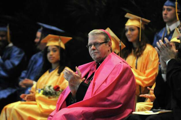 Bishop Edward B. Scharfenberger attends Bishop Maginn High School 35th Commencement Exercise on Saturday June 13, 2015 in Albany , N.Y.  This will be the last graduation at the school's current location. It will relocate to a smaller space in the fall. Bishop Edward B. Scharfenberger will be on hand for the ceremony. He ultimately made the call to move. The school has about 138 students in a building designed for 1,200. The new location at Park Avenue  a former charter school that is half that size. (Michael P. Farrell/Times Union) Photo: Michael P. Farrell / 00032270A