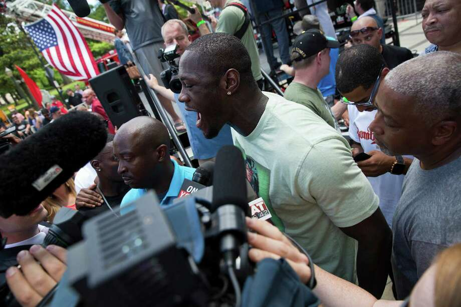 WBC heavyweight boxing champion Deontay Wilder speaks to the media after his weigh-in, Friday, June 12, 2015, in Birmingham, Ala. Wilder will defend his title for the first time against Eric Molina on Saturday. (AP Photo/Brynn Anderson) Photo: Brynn Anderson, STF / AP