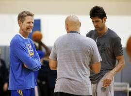 Golden State Warriors head coach Steve Kerr (left) talks during practice on Saturday, June 13, 2015 in Oakland, Calif.