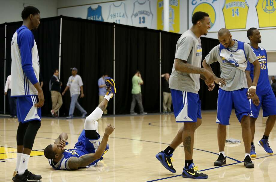 Golden State Warriors' Andre Iguodala (second left) rolls on the floor laughing while shooting three-pointers with teammates Justin Holiday (left), Brandon Rush (third right), Leandro Barbosa (second right) and Harrison Barnes (right) during practice on Saturday, June 13, 2015 in Oakland, Calif. Photo: Beck Diefenbach, Special To The Chronicle